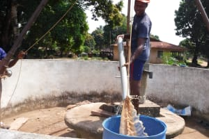 The Water Project: Lungi, Lungi Town, Holy Cross Primary School -  Bailing