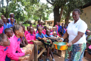 The Water Project: Lungi, Lungi Town, Holy Cross Primary School -  Hygiene Facilitator Showing The Result Of One Of The Handwashing Method