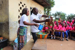 The Water Project: Lungi, Lungi Town, Holy Cross Primary School -  Hygiene Facilitator Teaching About Diarrhea