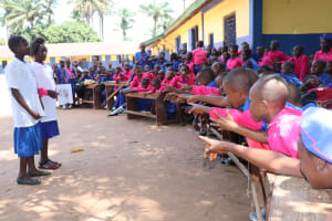 The Water Project: Lungi, Lungi Town, Holy Cross Primary School -  Pupils Teaching About Healthy And Unhealthy Community