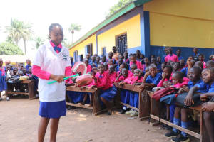 The Water Project: Lungi, Lungi Town, Holy Cross Primary School -  School Head Girl Demonstrating How To Clean Teeth