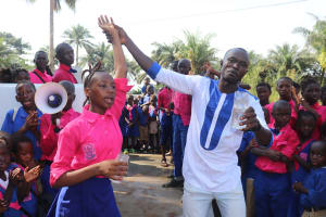 The Water Project: Lungi, Lungi Town, Holy Cross Primary School -  School Head Girl And Teacher Celebrating