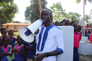 The Water Project: Lungi, Lungi Town, Holy Cross Primary School -  School Teacher Making Statement