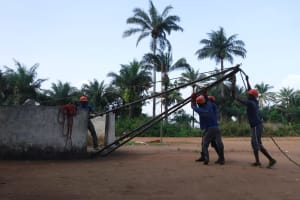 The Water Project: Lungi, Lungi Town, Holy Cross Primary School -  Setting Tripod