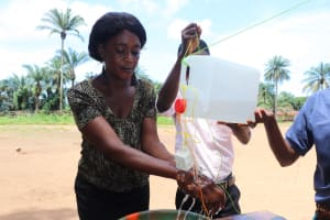 The Water Project: Lungi, Lungi Town, Holy Cross Primary School -  Supervisor Of School Demonstrating Tippy Tap Handwashing Method