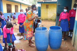 The Water Project: Lungi, Lungi Town, Holy Cross Primary School -  Teacher And Pupils Cleaning The School Compound
