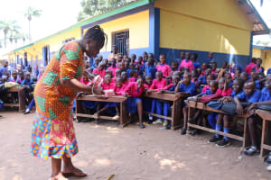 The Water Project: Lungi, Lungi Town, Holy Cross Primary School -  Teacher Demonstrating How To Clean Teeth