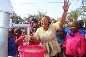 The Water Project: Lungi, Lungi Town, Holy Cross Primary School -  Teacher And Students Celebrate