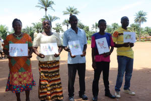 The Water Project: Lungi, Lungi Town, Holy Cross Primary School -  Teachers Displaying Disease Transmission Story Posters