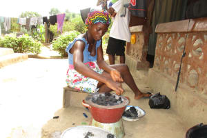 The Water Project: Lungi, Mahera, #5 MacAuley Street -  Lady Setting Fire For Cooking