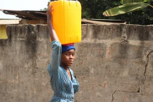 The Water Project: Lungi, Kingsway, 139 Kingsway Quarter -  Lady Carrying Water