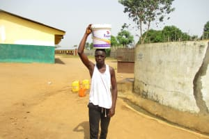 The Water Project: Lungi, Kingsway, 139 Kingsway Quarter -  Young Boy Carrying Water