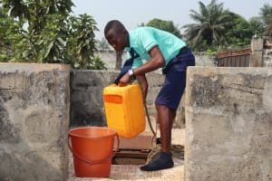 The Water Project: Lungi, Tardi, Khodeza Community School -  Student Collecting Water