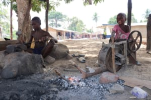 The Water Project: Kamasondo, Borope Village School -  Black Smith Workshop Kids Processing Cutlass