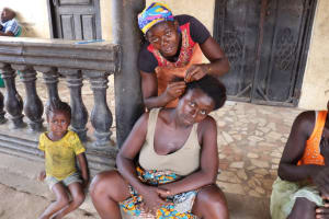 The Water Project: Kamasondo, Borope Village School -  Lady Braiding Hair