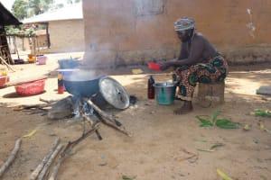 The Water Project: Kamasondo, Borope Village School -  Old Woman Cooking