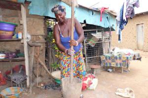 The Water Project: Kamasondo, Borope Village School -  Woman Pounding Rice
