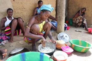 The Water Project: Kamasondo, Borope Village School -  Woman Dishing Food