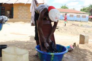 The Water Project: Kamasondo, Borope Village School -  Young Man Laundring