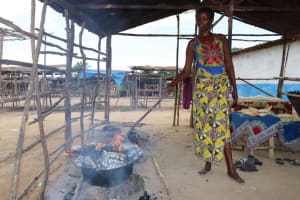 The Water Project: Kamasondo, Borope Village School -  Young Woman Breaking Bread In A Local Way