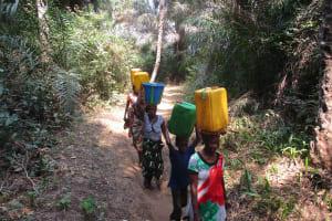 The Water Project: Lokomasama, Gbonkogbonko Village -  Community Members Carrying Water