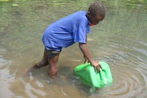 The Water Project: Lokomasama, Gbonkogbonko Village -  Small Boy Collecting Water