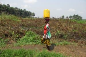 The Water Project: Lokomasama, Gbonkogbonko Village -  Woman Carrying