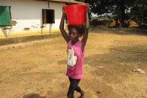 The Water Project: Lokomsama, Lumpa Wallah Village -  Kid Carrying Water