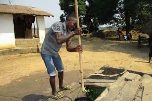 The Water Project: Lokomsama, Lumpa Wallah Village -  Sierra Leone Young Man Collecting Water
