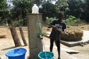 The Water Project: Lokomsama, Lumpa Wallah Village -  Small Boy Collecting Water