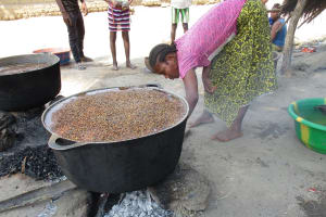 The Water Project: Lokomsama, Lumpa Wallah Village -  Woman Boiling Rice Seeds