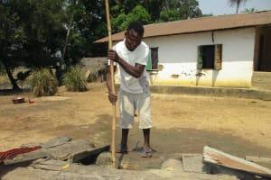The Water Project: Lokomsama, Lumpa Wallah Village -  Young Man Collecting Water