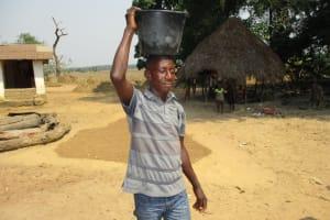 The Water Project: Lokomsama, Lumpa Wallah Village -  Young Man Carrying Water