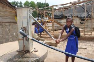 The Water Project: Kamasondo, Borope Village, Main Motor Rd. Junction -  Pupil Pumping Water