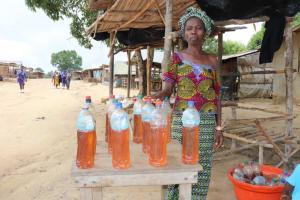 The Water Project: Kamasondo, Borope Village, Main Motor Rd. Junction -  Woman Selling Petrol By Liter