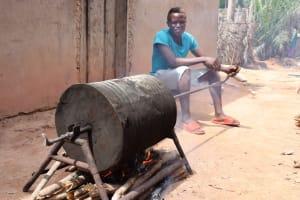 The Water Project: Kamasondo, Borope Village, Main Motor Rd. Junction -  Boy Roasting Groundnuts
