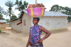 The Water Project: Kamasondo, Borope Village, Main Motor Rd. Junction -  Young Lady Carrying Palm Kanel