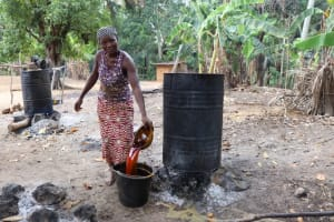 The Water Project: Kamasondo, Robombeh Village, Next to Mosque -  Woman Processing Palm Kernel