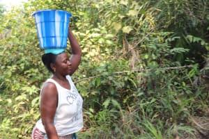 The Water Project: Lokomasama, Modia Dee -  Woman Carrying Water