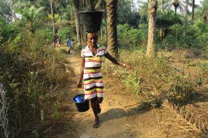 The Water Project: Lokomasama, Rotain Village -  Lady Carrying Water