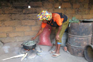 The Water Project: Lokomasama, Rotain Village -  Woman Cooking
