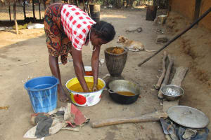 The Water Project: Lokomasama, Rotain Village -  Woman Processing Palm Oil