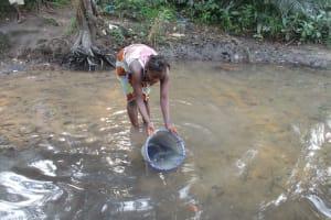 The Water Project: Lokomasama, Rotain Village -  Woman Collecting Water