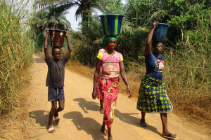 The Water Project: Lokomasama, Satamodia Village -  Community Members Carrying Water