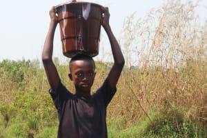 The Water Project: Lokomasama, Satamodia Village -  Small Boy Carrying Water