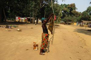 The Water Project: Lokomasama, Satamodia Village -  Woman Hanging Clothes