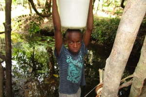 The Water Project: Polloth Village, Kroo Town Area -  Carrying Water