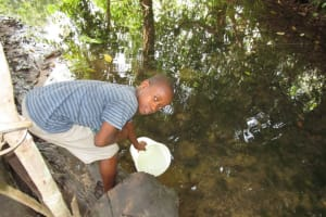The Water Project: Polloth Village, Kroo Town Area -  Fetching Water