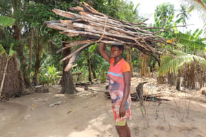 The Water Project: Polloth Village, Kroo Town Area -  Young Girl Carrying Fire Wood