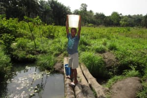 The Water Project: Polloth Village, Loco Area -  Carrying Water